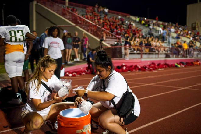 Rossview managers prepare bags of ice water for the players during the 2019 TOA CMCSS Football Jamboree at Fortera Stadium in Clarksville, Tenn., on Friday, Aug. 16, 2019.
