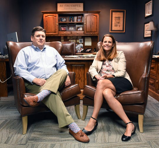 Chad and Jennifer Frese, the attorneys representing Mollie Tibbetts' suspected killed, Cristhian Bahena Rivera, pose for a portrait inside their Marshalltown office on Aug. 7, 2019. It is the first case they took on together since their marriage in 2018.