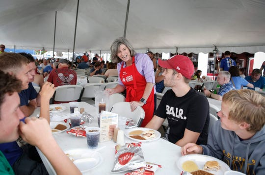 United States Sen. Joni Ernst (R-Iowa) visits with families inside the Iowa Pork Tent at the Iowa State Fair where she helped serve water on Saturday, August 17, 2019. Ernst, responding to an earlier remark made by Iowa republican congressman Steve King, stated that never is rape or incest okay.