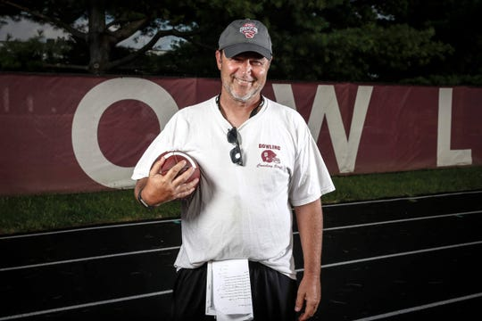 Tom Wilson, the head football coach at Dowling Catholic, poses for a portrait shot at Dowling Catholic High School on Wednesday, August 14, 2019.