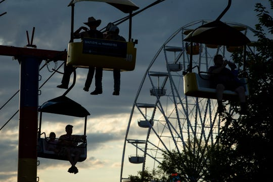 People ride the Sky Glider during the the Iowa State Fair on Friday, Aug. 16, 2019 in Des Moines.