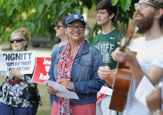 Rep. Rashida Tlaib listens as Jake Erlich plays a song during the Sabbath held in her honor at Pallister Park in Detroit Friday, August 16, 2019.