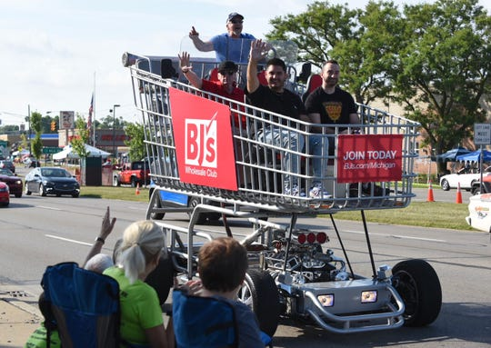 A giant shopping cart called the Shopper Chopper and driven by Cal VanSant (built by VanSant and son-in-law Brent Muster) delights Dream Cruise spectators along Woodward Avenue near 13 Mile in Royal Oak on Saturday.