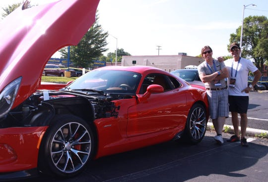 Marco Zaccagnini, left, and brother Tonino, both from Lake Orion, showed off their 2014 SRT Viper GTS in the parking lot of PMD Garage in Pontiac on Saturday.