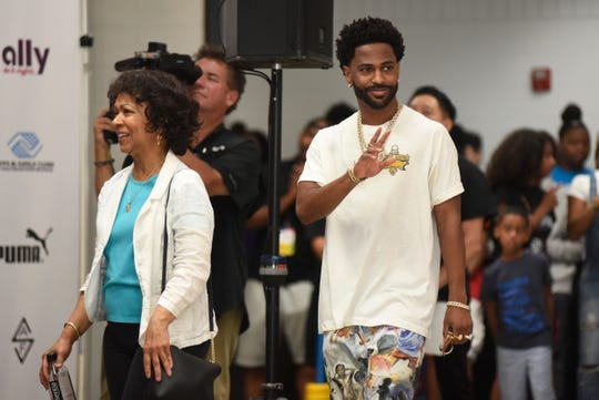 Sean Anderson, known as Big Sean, and his mother Myra Anderson, left, head to the stage as they are acknowledged by the crowd, Saturday, Aug. 17, 2019 in Detroit.  (Jose Juarez/Special to Detroit News)