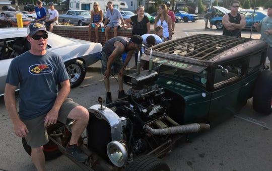 Tim Borgne, 52, of Owasso, Oklahoma, shows off an explosive 1928 Chevrolet on Saturday.