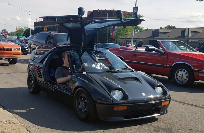This 1992, gull-winged, mid-engine Mazda Autozam AZ-1 appeared at Saturday's Dream Cruise.