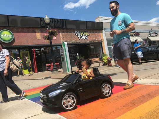 Adelynn Harris, 18 months, rides in style in a miniature Mercedes SL500 during Saturday's Dream Cruise.