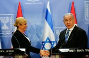 Israeli Prime Minister Benjamin Netanyahu, right, shakes hands with Croatian President Kolinda Grabar-Kitarovic, during a media conference at the Prime Minister's office in Jerusalem, July 29.