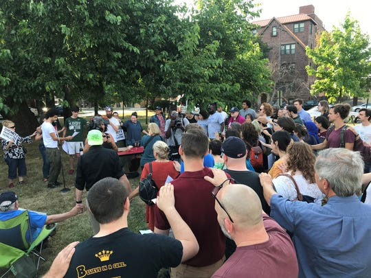 JVP Action (Jewish Vote for Peace), a liberal nonprofit, led the event where about 60 people held candles, joined together in songs and rituals with Tlaib near her district office at Pallister Park on Friday, Aug. 16, 2019.