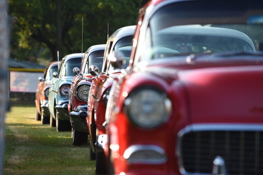 A line of 1955, 1956 and 1957 Chevrolet classics begin to line up at Memorial Park in Royal Oak for the Woodward Dream Cruise on Saturday.