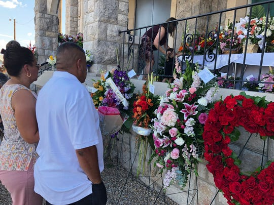 Mourners deliver flowers on Friday, Aug. 16, 2019, for the funeral in El Paso, Texas, of Margie Reckard, 63, who was killed by a gunman in a mass shooting earlier in the month. Hundreds of strangers from El Paso and around the country came to pay their respects Friday after her husband, Antonio Basco, said he felt alone planning her funeral. He invited the world to join him in remembering his companion of 22 years.