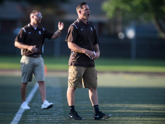 Central's new Head Coach Sean Coultis yells as he watches his team take on the Gibson Southern Titans during a pre-season scrimmage at Central Stadium in Evansville, Ind., Friday, Aug. 16, 2019.