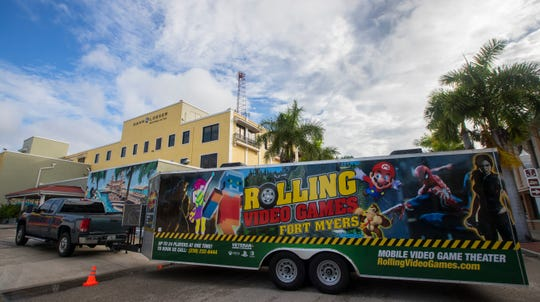 The Rolling Video Games Fort Myers trailer was stationed along First Street in Downtown Fort Myers during the Music Walk event Friday August 16, 2019. The Family-owned business offers various titles on Xbox One, Playstation 4 and Nintendo Switch in a temperature-controlled Òstate-of-the-artÓ gaming trailer.