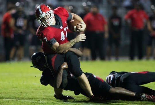 North Fort Myers High School's Logan Kobylansk breaks free from a Port Charlotte defender on Friday in Port Charlotte.