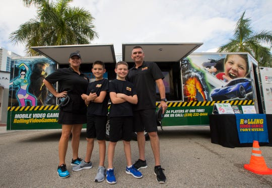 The family-owned Rolling Video Games Fort Myers offers various titles on Xbox One, Playstation 4 and Nintendo Switch in a temperature-controlled state-of-the-art gaming trailer. From left, Nicole, Connor, Liam and Ryan O'Hare.