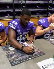 Three players who could be key contributors to Furman's offense in 2019 - tailbacks Corey Watkins (3), Wayne Anderson, Jr. (21), and Devin Wynn (22) - interact with fans at Furman's Fan Fest in Timmons Arena on Saturday.