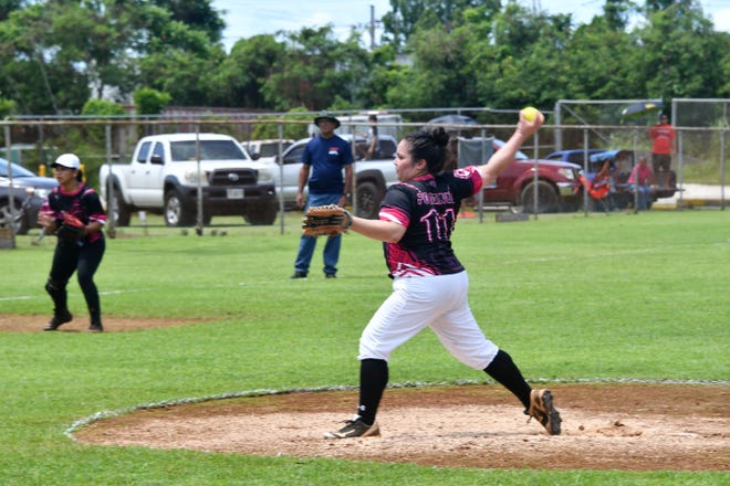 Ritana Pocaigue lets loose on a pitch for the Queen Bs during APL Womens Fastpitch Softball action in Piti. Pocaigue pitched a complete game in the win.