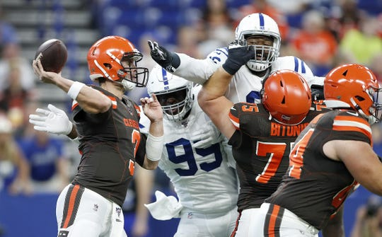 Indianapolis Colts defensive end Justin Houston (99) and defensive tackle Denico Autry (96) fight to get to Cleveland Browns quarterback Garrett Gilbert (3) in the first half of their preseason game at Lucas Oil Stadium on Saturday, August 17, 2019.
