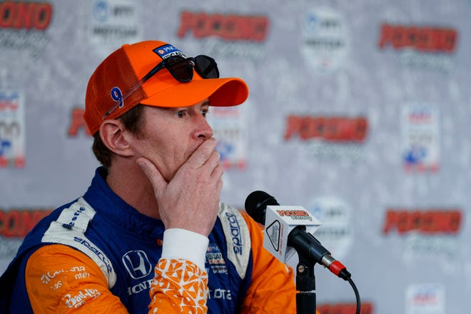 Scott Dixon listens to a question during a news conference for Sunday's IndyCar Series auto race at Pocono Raceway, Saturday, Aug. 17, 2019, in Long Pond, Pa. (AP Photo/Matt Slocum)