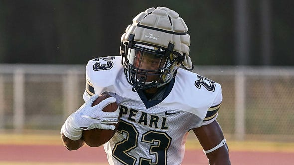 Pearl running back Kenyatta Harrell (23) runs the ball against Brandon during the Northwest Rankin Football Jamboree held Aug. 16 in Flowood, Mississippi.