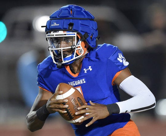 Madison Central quarterback Jimmy Holiday (1) runs the ball against Ridgeland in the Madison County High School Football Jamboree at Germantown High School in Gluckstadt, Miss., on Friday, August 16, 2019.