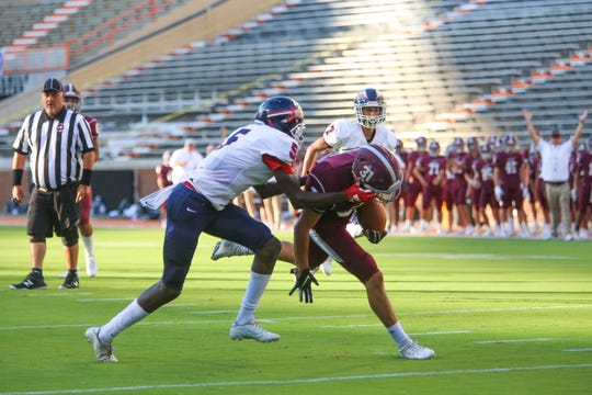 Bearden's Kishion Jones (31) is tackled by South Doyle's Mohamed Sanoe (5) during the Knoxville Orthopaedic Clinic Kickoff Classic at Neyland Stadium in Knoxville Friday, August 16, 2019.