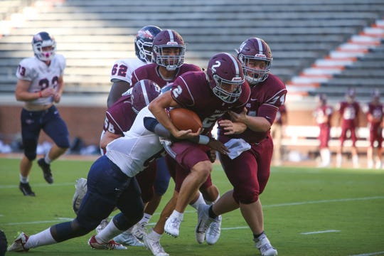 Bearden's Collin Ironside is tackled by by a player from South Doyle during the Knoxville Orthopaedic Clinic Kickoff Classic at Neyland Stadium in Knoxville Friday, August 16, 2019.