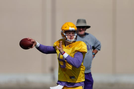 LSU quarterback Joe Burrow (9) works out during their NCAA college football practice in Baton Rouge, Wednesday, Aug. 7, 2019.
