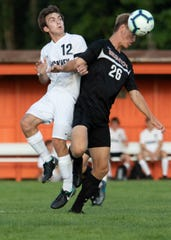 Brighton's Joshua Adam (26) and Pinckney's Nic Brousseau (12) battle for the ball in Brighton's 4-1 victory over Pinckney on Friday, Aug. 16, 2019.
