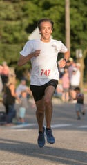 Howell's Patrick Miller won the Howell Melon Run 10K on Friday, Aug. 16, 2019 after winning the 5K the last two years.