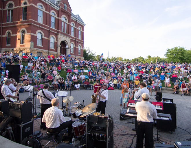 A crowd surrounds the Howell Courthouse Amphitheater to listen to Steve King and the Dittilies at the Howell Melon Festival Friday, Aug. 16, 2019. This year's Melon Festival concerts will look similar, as festivities will take place on the courthouse lawn Aug. 13-15.