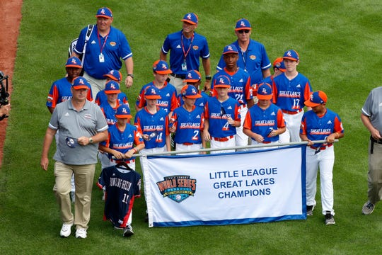 The Great Lakes Region Champion Little League team from Bowling Green, Ky., carries the jersey of a friend and teammate they lost at age 10 -- Mason Goodnight, whose dad, Jef, is an assistant coach, as they participate in the opening ceremony of the 2019 Little League World Series tournament in South Williamsport, Pa.