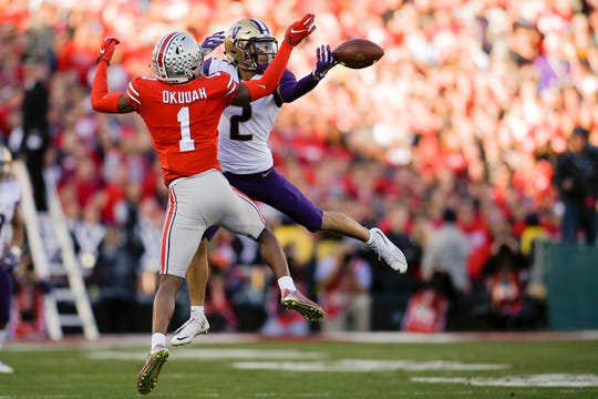 Ohio State cornerback Jeffrey Okudah breaks up a pass intended for Washington receiver Aaron Fuller in the 2019 Rose Bowl.