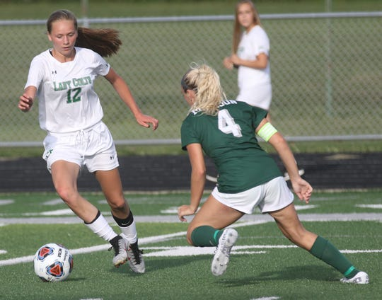 Clear Fork's Lilly Wortman makes a move against Madison's Julia Litt. Wortman scored a goal in a 2-0 win over Wooster on Monday.
