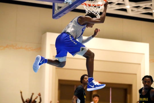 Memphis Tigers guard Damion Baugh dunks the ball against the Bahamas National Team during their exhibition game at the Grand Hyatt Baha Mar's New Providence Ballroom on Saturday, August 17, 2019.