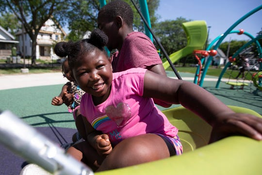 Chyonna Slater, 5, rides a swing at Columbia Playfield.