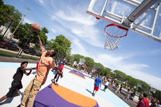 Community members play basketball at Columbia Playfield, the renovated park at 1345 W. Columbia St.