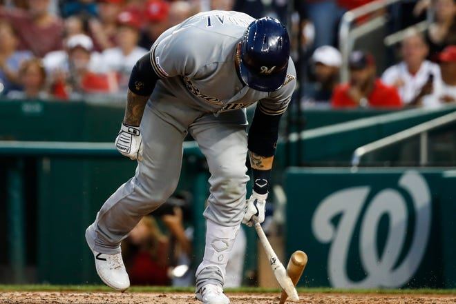 The Brewers' Yasmani Grandal breaks his bat after striking out swinging with the bases loaded during the third inning.
