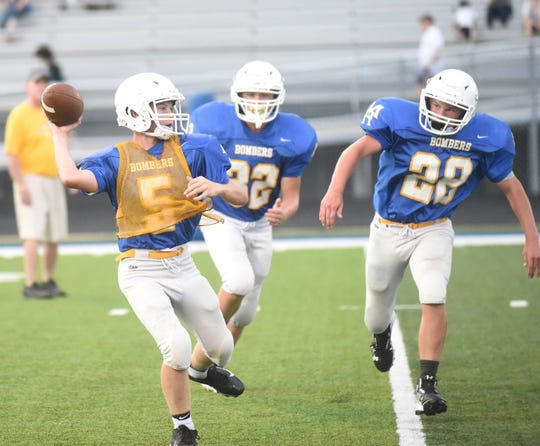 Mountain Home Junior Bomber quarterback Dillon Drewry passes during Friday's scrimmage.