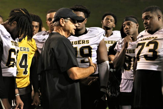 Grambling State offensive coordinator Mark Orlando talks with his players after a practice earlier this fall camp.