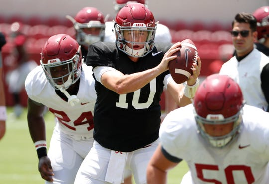 Alabama redshirt sophomore quarterback Mac Jones (10) takes a snap during a preseason scrimmage Aug. 10, 2019 from Bryant-Denny Stadium in Tuscaloosa, Ala. (Photo by Kent Gidley/Alabama athletics)