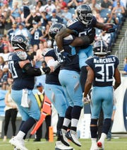 Tennessee Titans tight end Delanie Walker (82) celebrates his touchdown catch in the first quarter of a preseason game against the New England Patriots at Nissan Stadium Saturday, Aug. 17, 2019 in Nashville, Tenn.