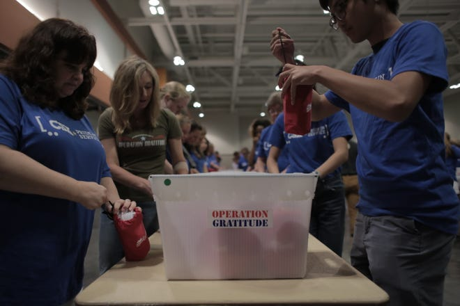 Volunteers in Nashville fill care packages for police, firefighters and military members.