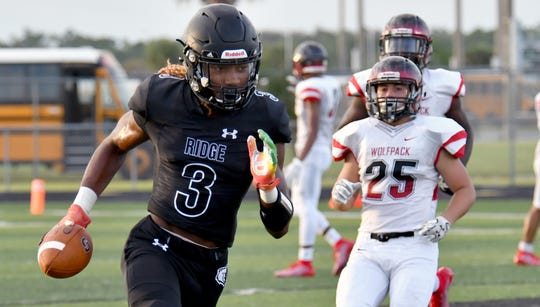 Palmetto Ridge Kamonte Grimes (3) runs the ball during their game against South Fort Myers High School in Naples, Friday, Aug. 16, 2019. (Chris Tilley Photo)