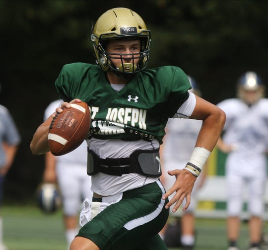 St. Joseph quarterback Michael Alaimo as he runs against Pope John who came to play St. Joseph in Montvale for a high school football pre season scrimmage on August 17, 2019.