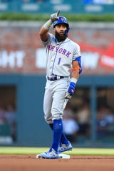 Amed Rosario #1 of the New York Mets doubles in the first inning during the game against the Atlanta Braves at SunTrust Park on August 15, 2019 in Atlanta, Georgia.