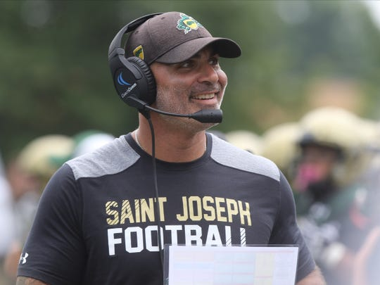 St. Joseph head coach Augie Hoffman likes what he saw as his team goes up against Pope John who came to play St. Joseph in Montvale for a high school football pre season scrimmage on August 17, 2019.