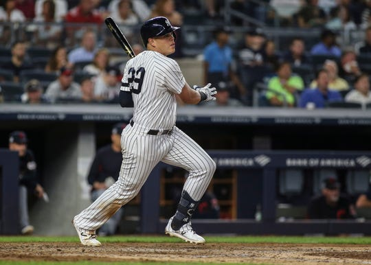Yankees designated hitter Gio Urshela (29) hits an RBI single in the fifth inning against the Cleveland Indians at Yankee Stadium.
