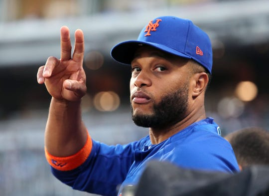 Aug 16, 2019; Kansas City, MO, USA; New York Mets second baseman Robinson Cano (24) waves to fans during the third inning against the Kansas City Royals at Kauffman Stadium.